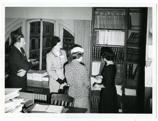 Historic Photos Collection - Photo of Library staff looking at resources, circa 1964