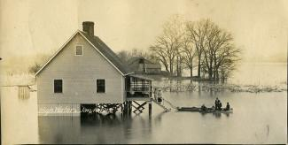 View of house, people during a flood, 1913